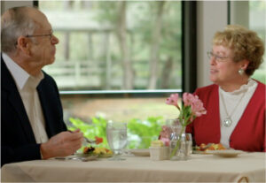 Happy Couple Eating at The Seabrook Hilton Head - Retirement Community